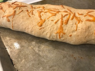 Baked Stromboli with cheddar baked on top